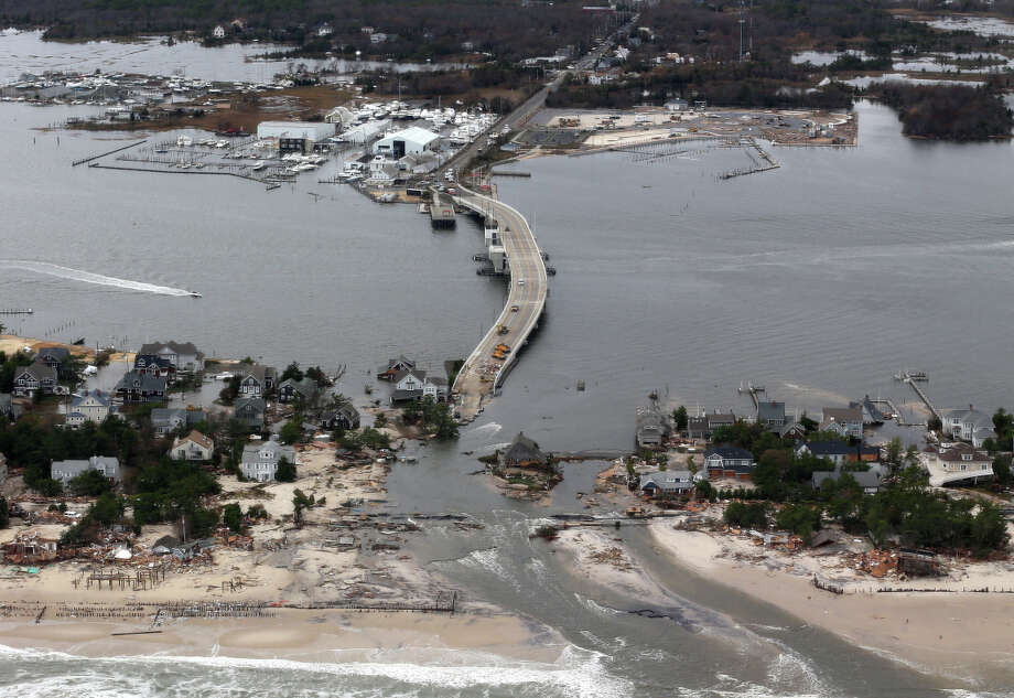 The American Society of Civil Engineers is urging the U.S. to create a flood plan, citing damage like Superstorm Sandy's, above, in Manoloking, N.J. Photo: Doug Mills, POOL / Associated Press / Pool The New York Times