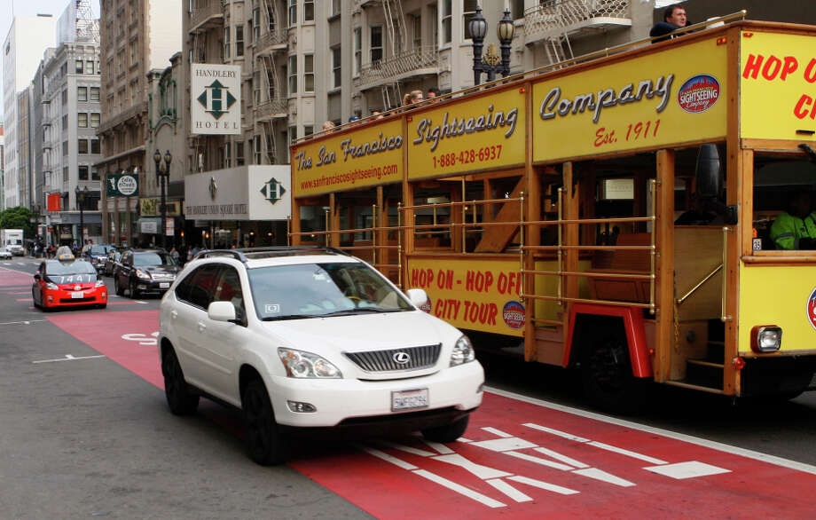 An Uber driver rides in a transit lane on Geary Street in San Francisco, a practice opposed by traditional taxi drivers. Photo: Terray Sylvester, Intern / The Chronicle / ONLINE_YES