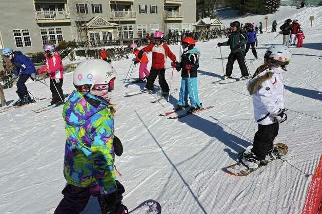 Skiers at enjoy a nice day at Jiminy Peak ski area Friday, Feb. 7, 2014, in Hancock, Mass.   (Lori Van Buren / Times Union) Photo: Lori Van Buren / 00025671A