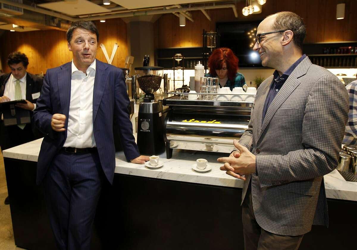 Italian Prime Minister Matteo Renzi (left) enjoyed a light moment at the espresso bar with Twitter CEO Dick Costolo (right) at Twitter headquarters in San Francisco, Calif. The Italian Prime Minister Matteo Renzi made a whirlwind tour of San Francisco and Silicon Valley including a stop at Twitter headquarters Monday September 22, 2014.
