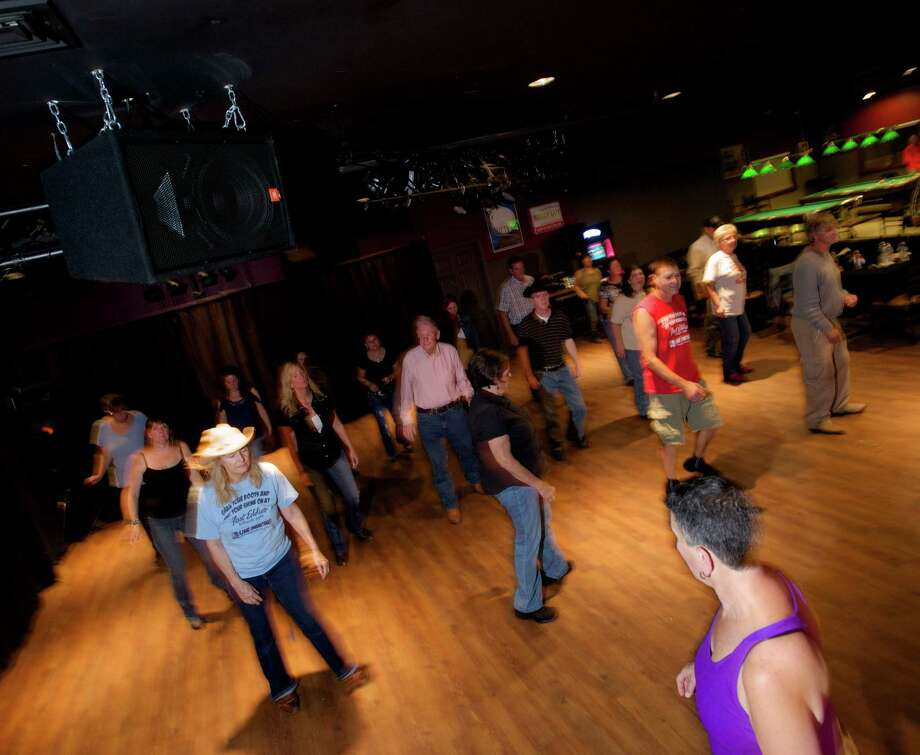 A line-dance party is held on the first and third Friday of every month at Fast Eddie's Billiard Cafe, in New Milford, Conn. Jill Weiss does instruction starting at 6:30 p.m. and open dance starts at 8:30 p.m. and lasts until 11 p.m. Photo: H John Voorhees III / The News-Times Staff Photographer