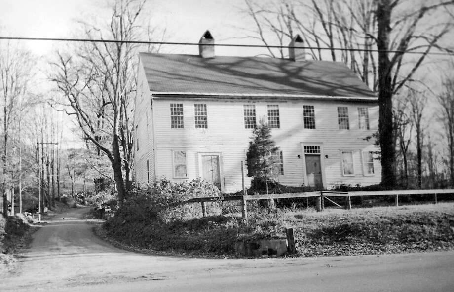 Seven Hearths is one of the oldest buildings in Kent and is located in the Flanders Historical District, which was the center of town in the 1700s. This image of  Seven Hearths shows the houses and land with a walking path where Studio Hill Road is today. Photo: Contributed Photo/ Kent Historic, Contributed Photo / The News-Times Contributed