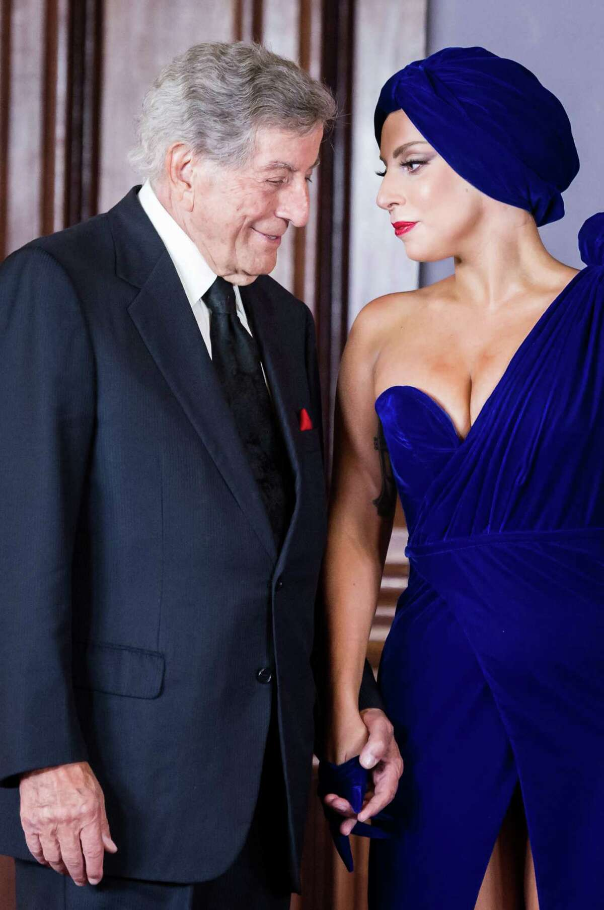 Lady Gaga, right, and Tony Bennett arrive for a media event at the Brussels' city hall on Monday Sept. 22 , 2014. Lady Gaga and Tony Bennett will give a short concert on the Brussels' Grand Place for 6500 clients of mobile operator Mobistar.
