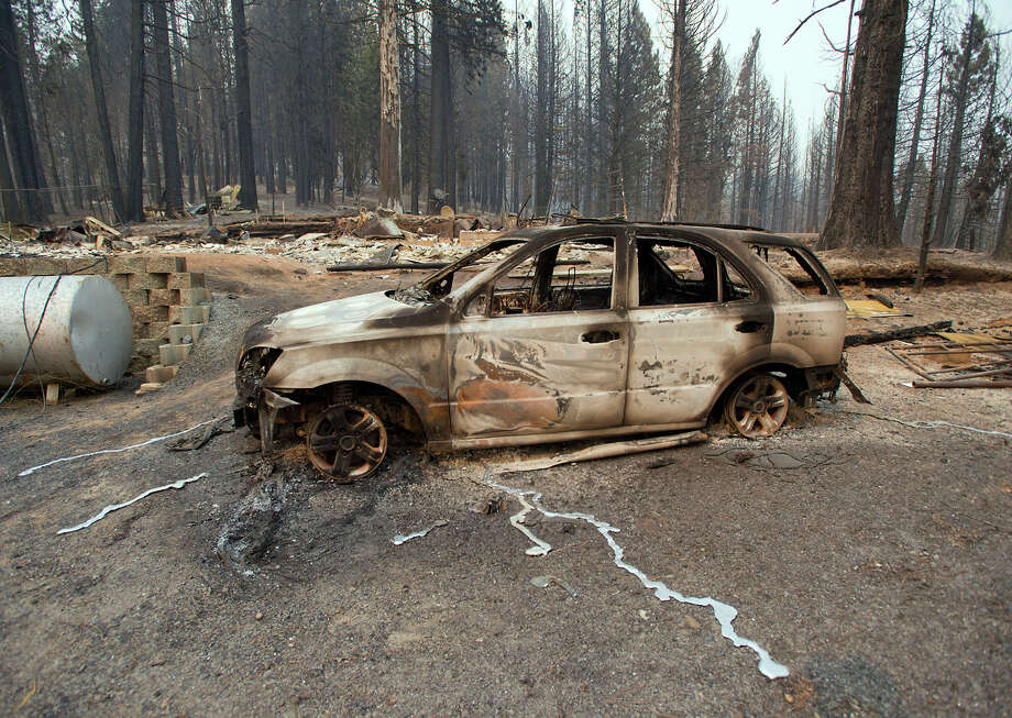 A charred car is almost all that remains Friday at the site of a home burned in the King Fire near the town of Icehouse (El Dorado County). Photo: Randall Benton / Randall Benton / Sacramento Bee / The Sacramento Bee
