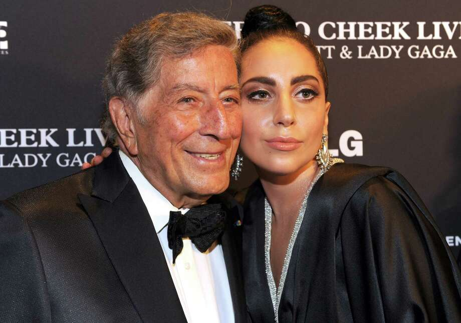 "Tony Bennett and Lady Gaga just announced they'll be going on tour together next year, including a stop in the Bayou City on April 24 at the Cynthia Woods Mitchell Pavilion. While the duo did knock out an amazing rendition of ""The Lady is a Tramp"" in 2011, it's a pairing you wouldn't expect.This isn't the first time two unlikely artists joined forces in the name of music. They're not even the only odd couple who announced this week that they'll be performing in Houston. Keep clicking to find out what other peculiar pairing is heading to the Bayou City, then keep clicking to see what other artists have worked together...for better or for worse. Photo: Kevin Mazur, Contributor / 2014 Kevin Mazur"