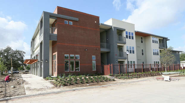 The leasing office and apartment units in Phase III of The Gardens at San Juan Square at 2003 S. Zarzamora on Monday, Sept. 8, 2014.  In addition to the 12 residential/commercial units, the project includes 240 apartment units and commericial space.  It it estimated to be completed this December.  MARVIN PFEIFFER/ mpfeiffer@express-news.net Photo: Marvin Pfeiffer/ Express-News / Express-News 2014