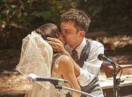 Annelise Grimm and Paul McCarthy kiss at their July 5 wedding at the Ben Lomond Quaker Retreat Center near Santa Cruz.