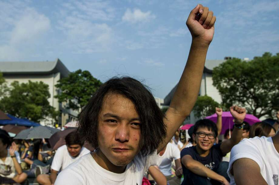 Hong Kong students gathered Monday in their thousands for what democracy activists say will be a wider campaign of civil disobedience against China's refusal to grant the city unfettered democracy. Photo: XAUME OLLEROS, Stringer / AFP