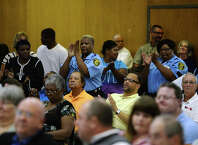Employees of the BISD Police Department applaud comments by Chief Clydell Duncan during Thursday night's board of managers meeting. The Beaumont Independent School District board of managers met Thursday night for their regular meeting. Photo taken Thursday 9/18/14 Jake Daniels/@JakeD_in_SETX