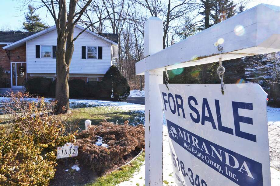 For sale sign outside a home at 1032 Hickory Road in Niskayuna Tuesday Jan. 22, 2013. (John Carl D'Annibale / Times Union) Photo: John Carl D'Annibale / 00020842A