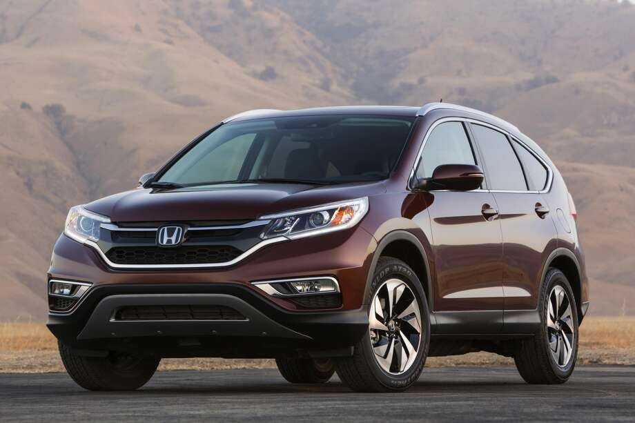 Honda has revealed the new 2015 CR-V, which has a sleek, more aggressive look than the 2014 model. The vehicle will be available October 1.Click through to take a peek at the all of the redesigned 2015 models unveiled thus far. Photo: Newspress USA