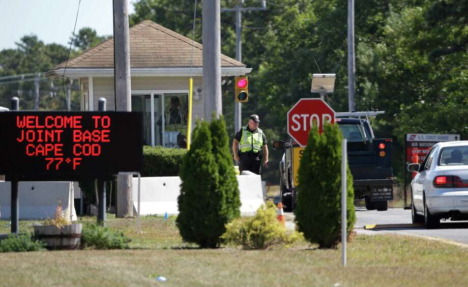Vehicles are stopped Monday by security personnel as they enter a gate to Camp Edwards, Mass., on Cape Cod. Police and military officials were searching for three soldiers from the Afghanistan National Army who went missing. Photo: Steven Senne, STF / AP