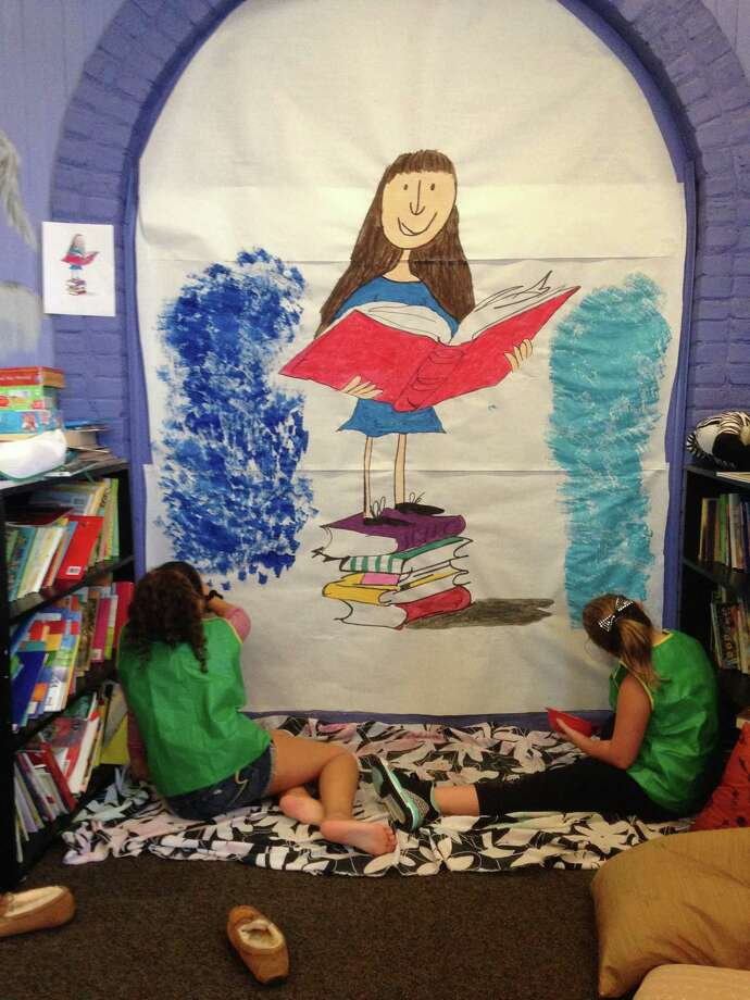 "Youths in group 3 at the Hope 7 Community Center in Troy painted new murals in their reading nook. ""We couldn't be happier with how it turned out,"" Program Director Samantha Adkisson wrote."