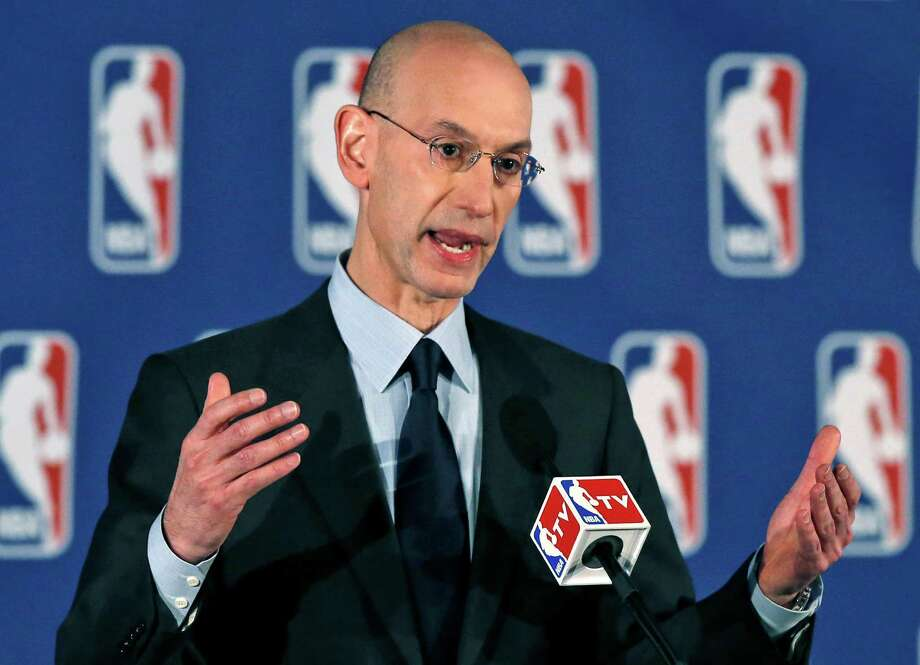 "FILE - In this April 29, 2014, file photo, NBA Commissioner Adam Silver addresses a news conference in New York. Silver says his league will ""take a fresh look"" at its domestic violence procedures following the rash of cases in the NFL.  (AP Photo/Kathy Willens, FILE) ORG XMIT: NY168 Photo: Kathy Willens / AP"