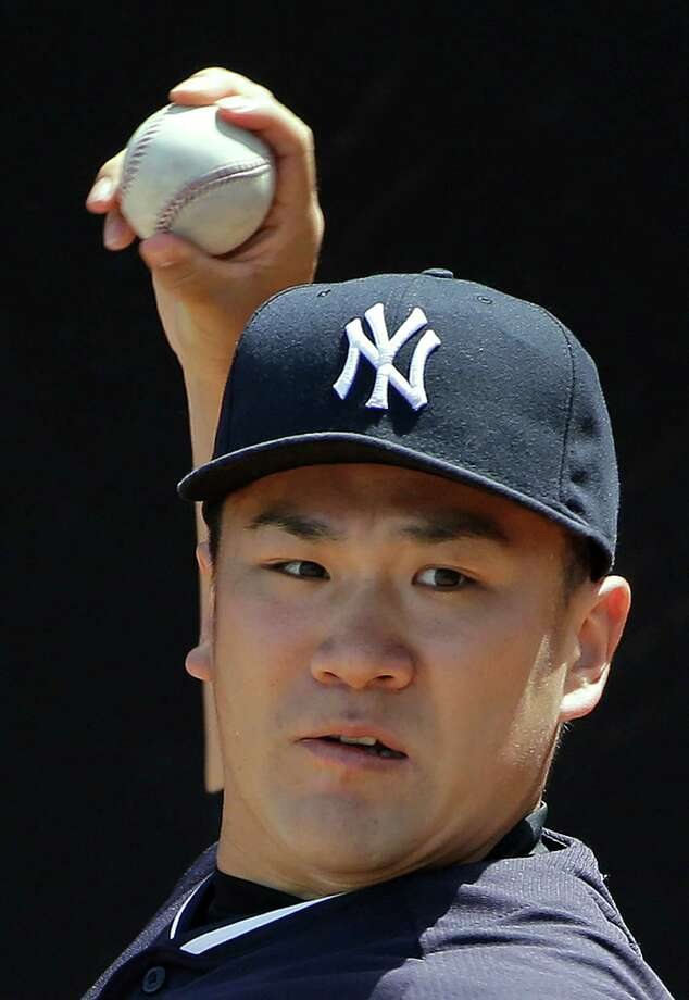 New York Yankees pitcher Masahiro Tanaka, of Japan, warms up in the bullpen before throwing a simulated game Monday, Sept. 15, 2014, in Tampa, Fla. Tanaka pitched five scoreless innings against minor leaguers in an instructional league simulated game Monday, perhaps the final step before the injured Japanese pitcher rejoins the New York Yankees. (AP Photo/Chris O'Meara) Photo: Chris O'Meara, STF / AP