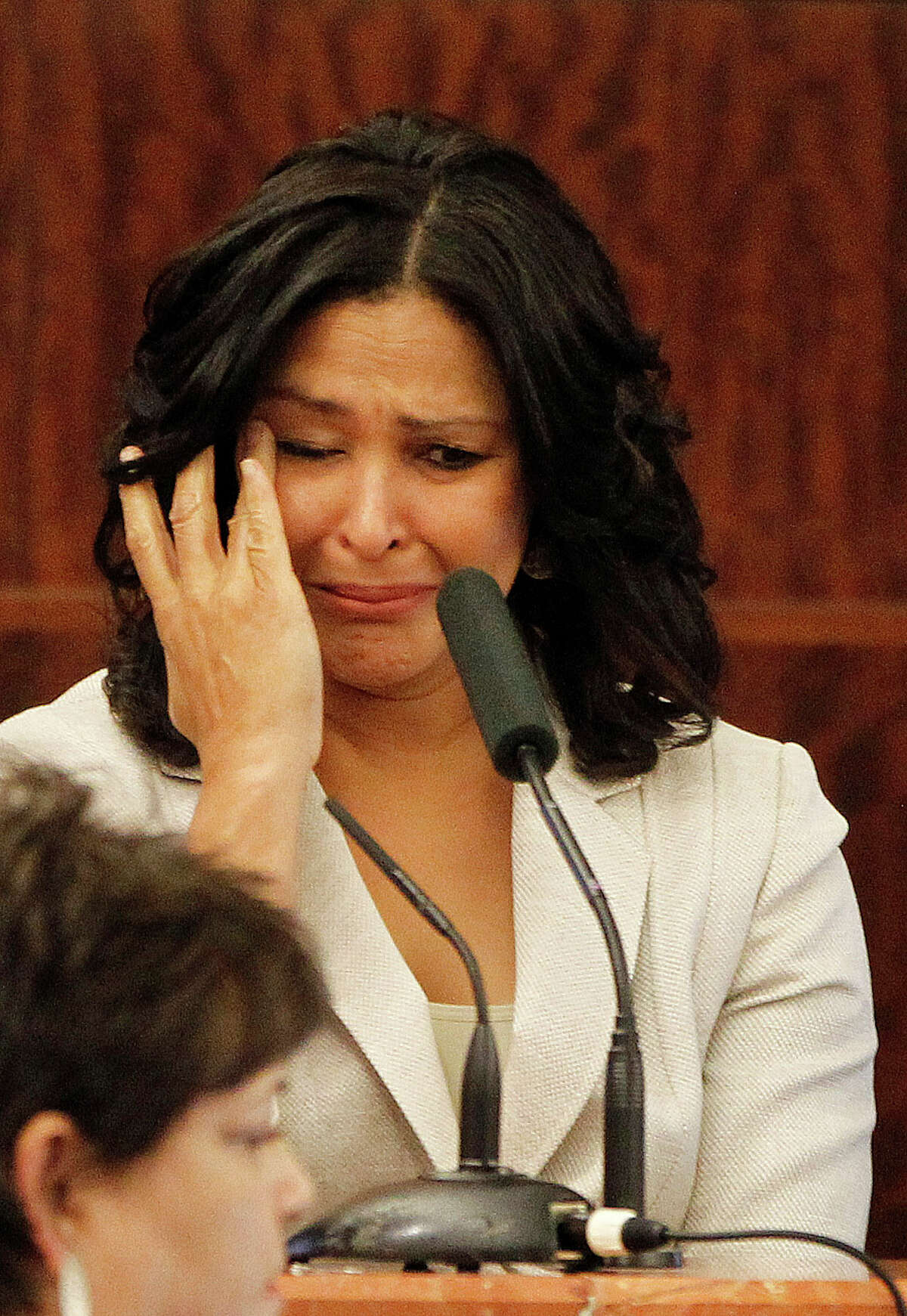 Evette Toney, the girlfriend of Dr. George Blumenschein, wipes tears as she talks about her miscarriage as she testifies during the trial of Dr. Ana Gonzalez-Angulo, the cancer doctor accused of poisoning her lover.