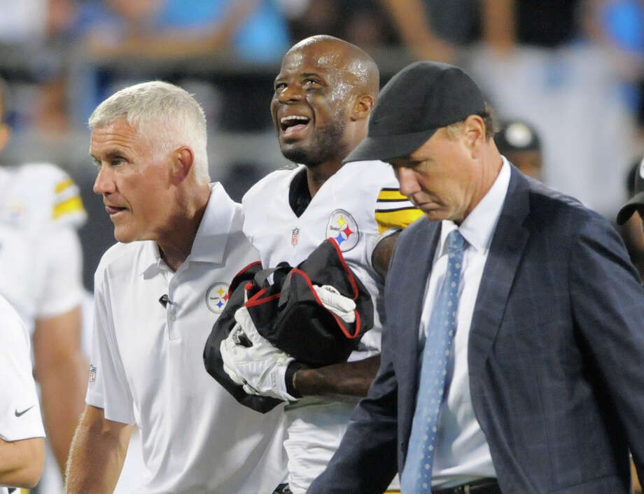 Pittsburgh Steelers' Ike Taylor, center is helped off the field by team members during the second half of an NFL football game against the Carolina Panthers in Charlotte, N.C., Sunday, Sept. 21, 2014. (AP Photo/Mike McCarn) Photo: Mike McCarn, FRE / FR34342 AP