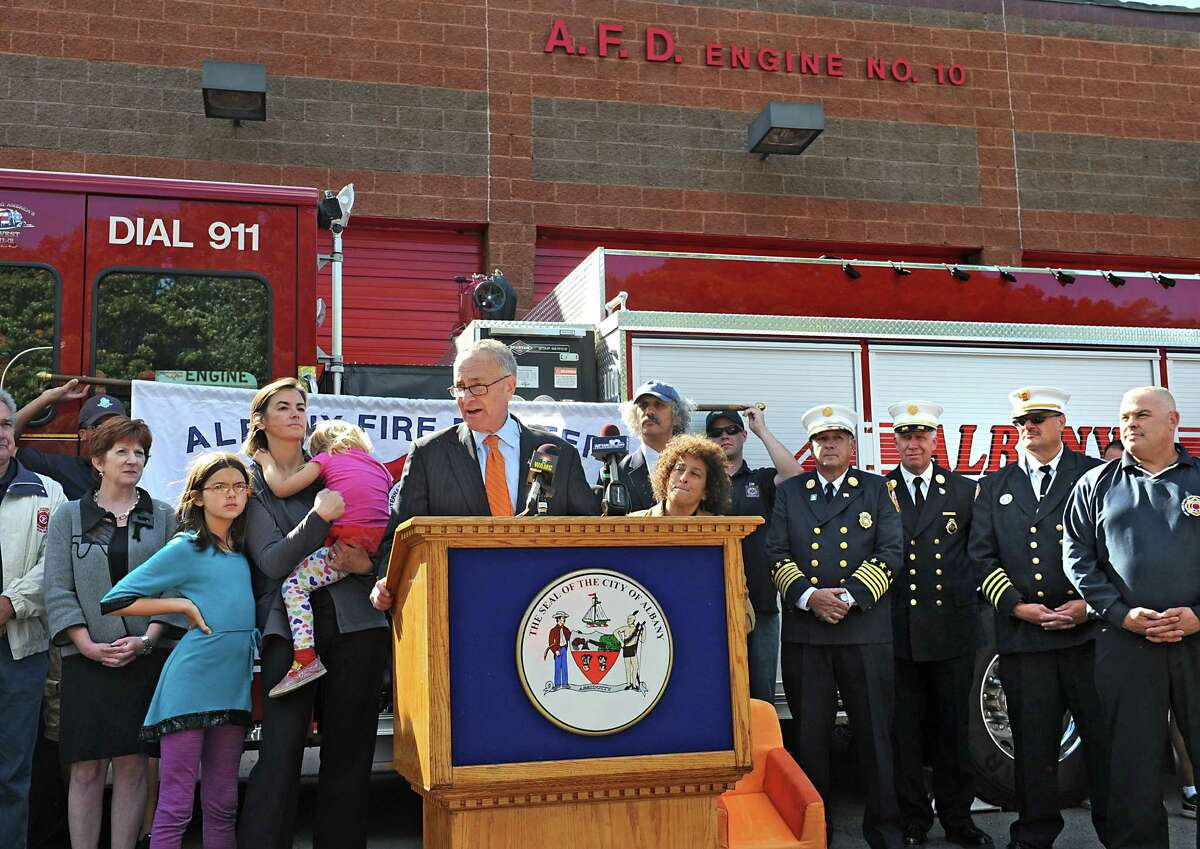 U.S. Senator Charles Schumer announces his push for new legislation that will ban the top ten noxious flame retardants from upholstered furniture and childrenOs products during a press conference at Firehouse of Engine 10/Ladder 3 on Monday, Sept. 22, 2014 in Albany, N.Y. (Lori Van Buren / Times Union)