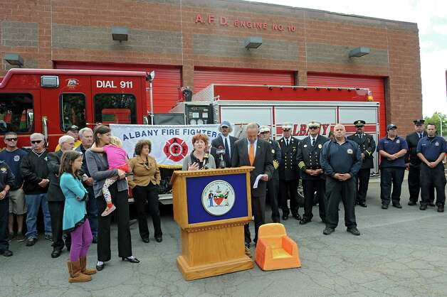 Albany Mayor Kathy Sheehan backs U.S. Senator Charles Schumer's push for new legislation that will ban the top ten noxious flame retardants from upholstered furniture and childrenOs products during a press conference at Firehouse of Engine 10/Ladder 3 on Monday, Sept. 22, 2014 in Albany, N.Y. (Lori Van Buren / Times Union) Photo: Lori Van Buren / 00028716A