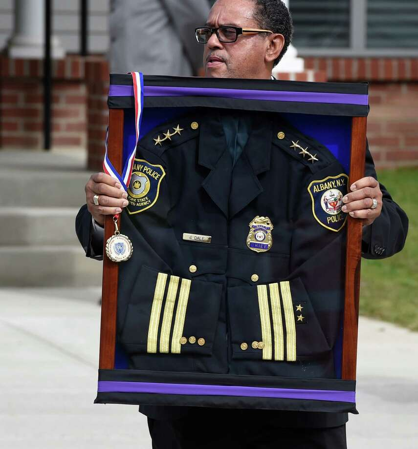 The uniform of former Albany Police Chief John Dale is carried from the Metropolitan NT Mission Baptist Church following funeral services Monday afternoon, Sept. 22, 2014, Albany, N.Y. Dale was buried in Albany Rural Cemetery.  (Skip Dickstein/Times Union) Photo: SKIP DICKSTEIN / 00028712A