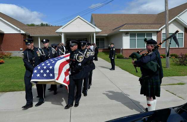 The casket carrying the remains of former Albany Police Chief John Dale leaves the Metropolitan NT Mission Baptist Church Monday afternoon, Sept. 22, 2014, Albany, N.Y. Dale was buried in Albany Rural Cemetery.  (Skip Dickstein/Times Union) Photo: SKIP DICKSTEIN / 00028712A