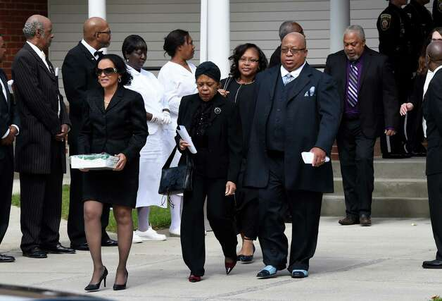 Family members who attended the funeral of former Albany Police Chief John Dale leave the Metropolitan NT Mission Baptist Church Monday afternoon, Sept. 22, 2014, Albany, N.Y. Dale was buried in Albany Rural Cemetery.  (Skip Dickstein/Times Union) Photo: SKIP DICKSTEIN / 00028712A