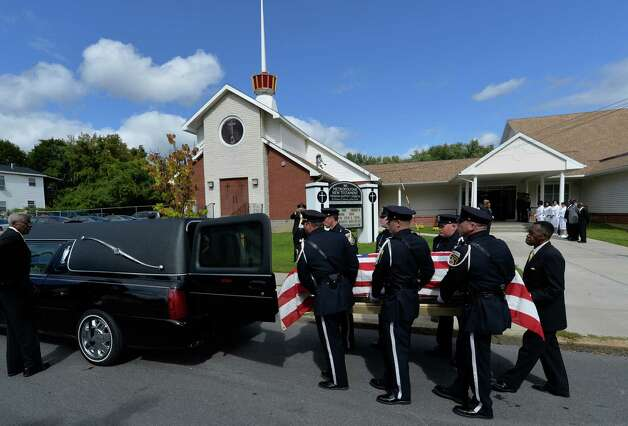 The casket carrying the remains of former Albany Police Chief John Dale leaves the Metropolitan NT Mission Baptist Church Monday afternoon Sept. 22, 2014, Albany, N.Y. Dale was buried in Albany Rural Cemetery.  (Skip Dickstein/Times Union) Photo: SKIP DICKSTEIN / 00028712A