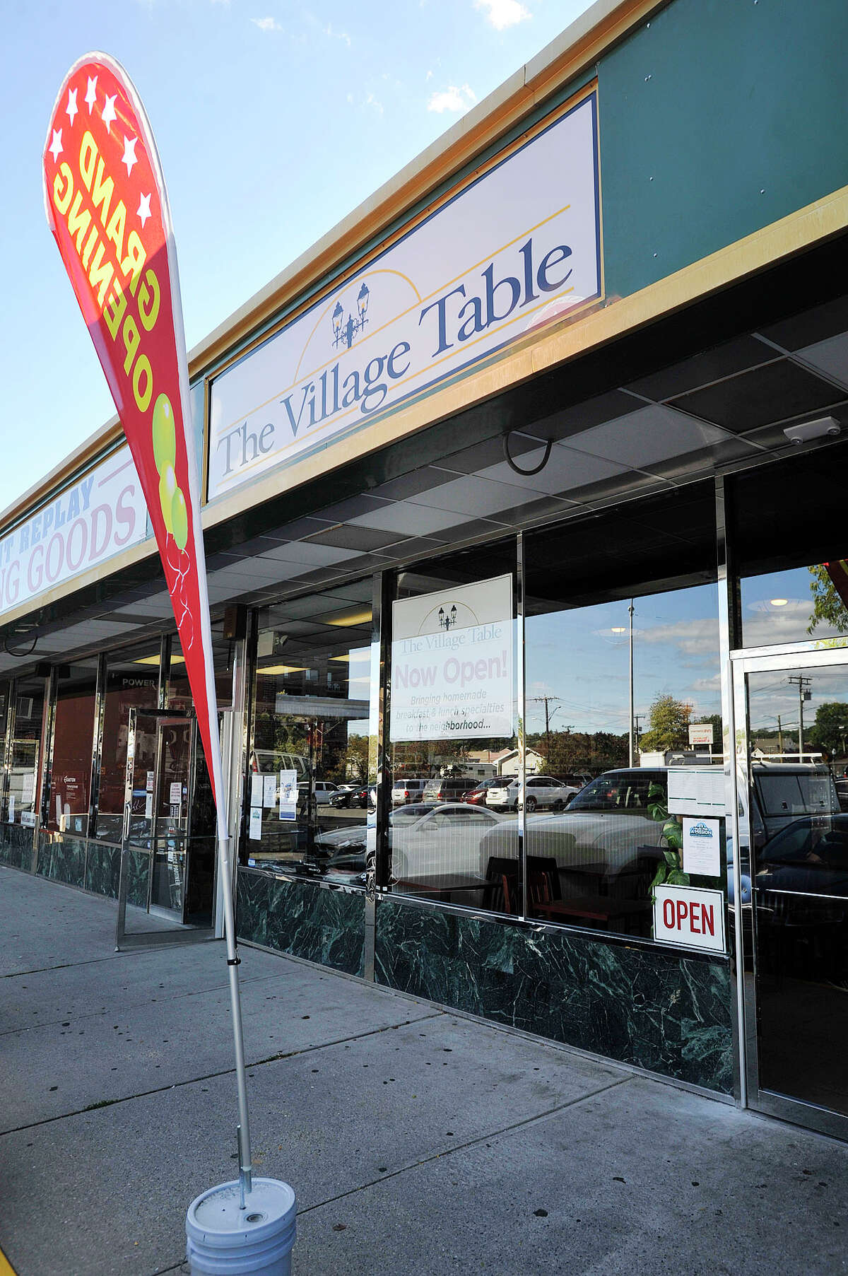 The exterior of The Village Table restaurant is seen among other shops in the Springdale Shopping Center in the Springdale section of Stamford, Conn., on Monday, Sept. 22, 2014. The Village Table opened three weeks ago where Kim's Kitchen used to be and offers breakfast and lunch and is open late on select days for dinner.