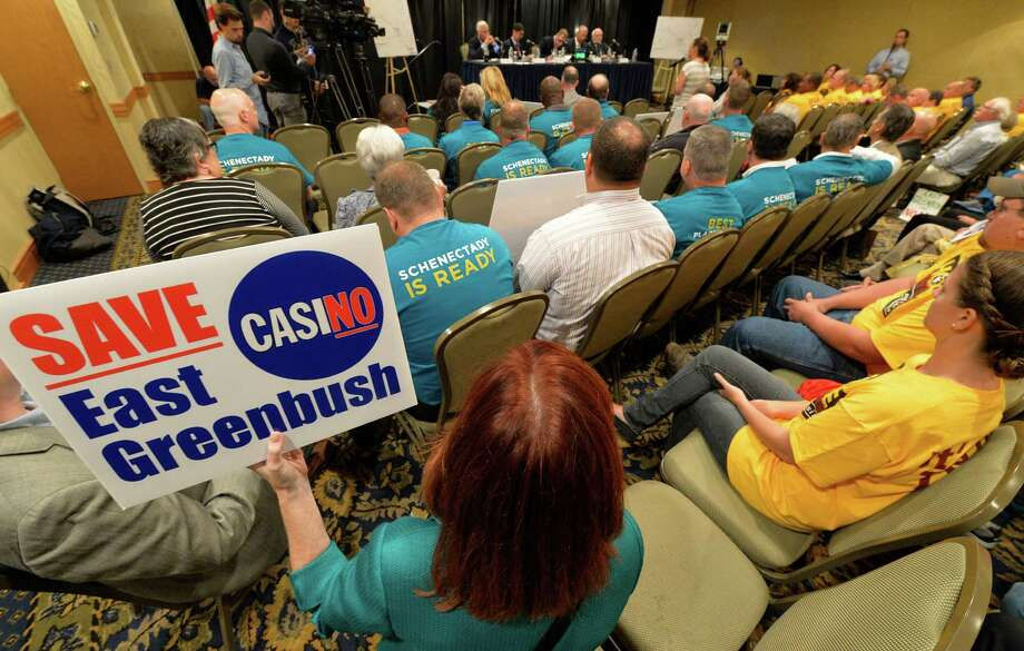 Different groups both for and against casinos put forth their thoughts during a public hearing on the location of casinos in the area Monday morning, Sept. 22, 2014, at the Holiday Inn Turf on Wolf Road in Colonie, N.Y. (Skip Dickstein/Times Union) Photo: SKIP DICKSTEIN / 00028632A