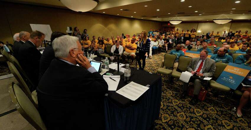 The Gaming Facility Location Board listens to different views during a public hearing on the location of casinos in the area Monday morning, Sept. 22, 2014, at the Holiday Inn Turf on Wolf Road in Colonie, N.Y. (Skip Dickstein/Times Union)