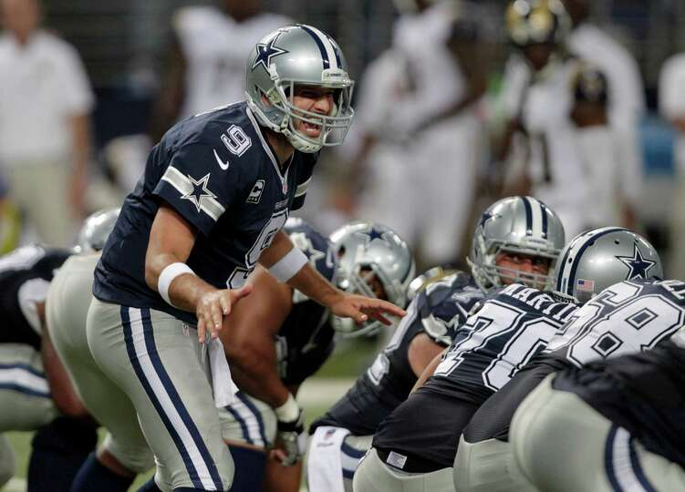 Dallas Cowboys quarterback Tony Romo yells on the line of scrimmage during the fourth quarter of an