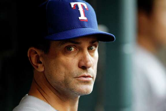 Former Houston Astros shortstop and current Texas Rangers bench coach Tim Bogar in the dugout during the first inning of an MLB game at Minute Maid Park, Wednesday, May 14, 2014, in Houston. ( Karen Warren / Houston Chronicle  )