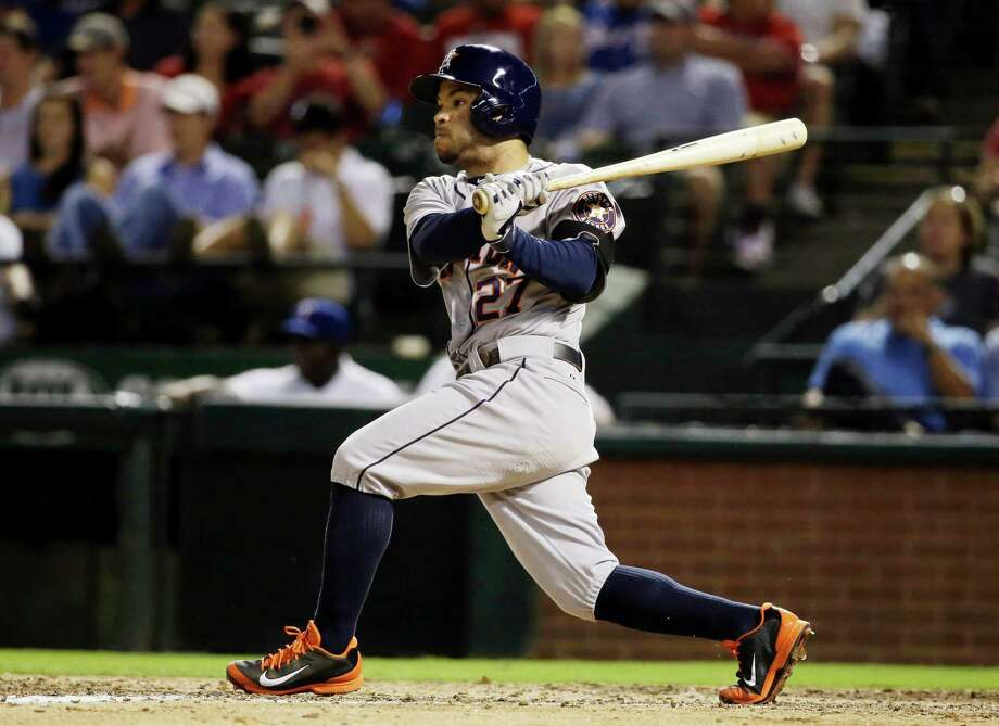 Jose Altuve strokes a run-scoring double in the sixth inning Monday night, his only hit in four at-bats in a 4-3 loss to the Rangers at Arlington. Story on Page C2. Photo: Tony Gutierrez, STF / AP