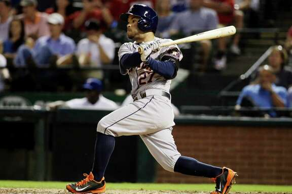 Jose Altuve strokes a run-scoring double in the sixth inning Monday night, his only hit in four at-bats in a 4-3 loss to the Rangers at Arlington. Story on Page C2.