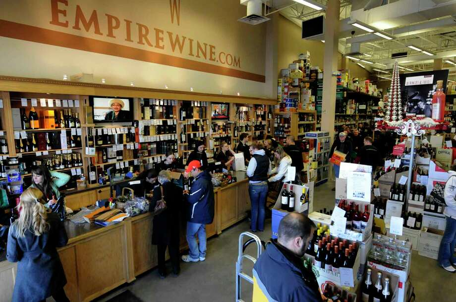 Holiday shoppers at Empire Wine in Colonie 12/24/2010.( Michael P. Farrell/Times Union ) Photo: Michael P. Farrell