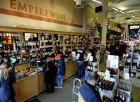 Holiday shoppers at Empire Wine in Colonie 12/24/2010.( Michael P. Farrell/Times Union )