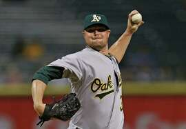 CHICAGO, IL - SEPTEMBER 09:  Starting pitcherJon Lester #31 of the Oakland Athletics delivers the ball against the Chicago White Sox at U.S. Cellular Field on September 9, 2014 in Chicago, Illinois.  (Photo by Jonathan Daniel/Getty Images)