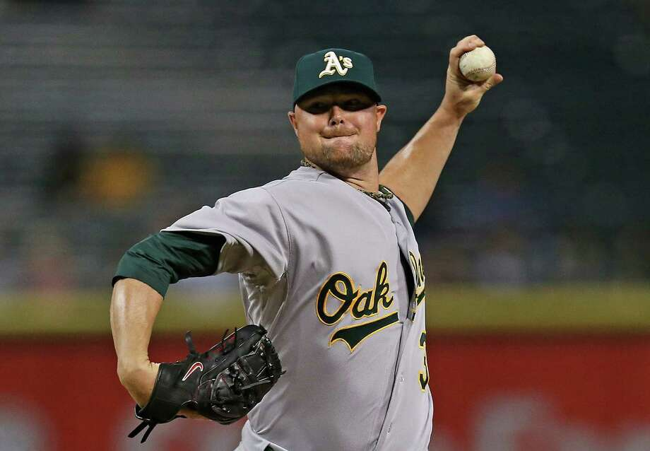 CHICAGO, IL - SEPTEMBER 09:  Starting pitcherJon Lester #31 of the Oakland Athletics delivers the ball against the Chicago White Sox at U.S. Cellular Field on September 9, 2014 in Chicago, Illinois.  (Photo by Jonathan Daniel/Getty Images) Photo: Jonathan Daniel / Getty Images / 2014 Getty Images