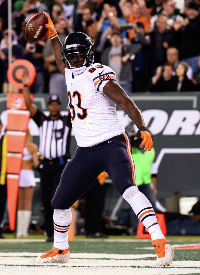 Bears tight end Martellus Bennett celebrates his 13-yard touchdown reception in the third quarter. Photo: Alex Goodlett, Stringer / Getty Images / 2014 Getty Images