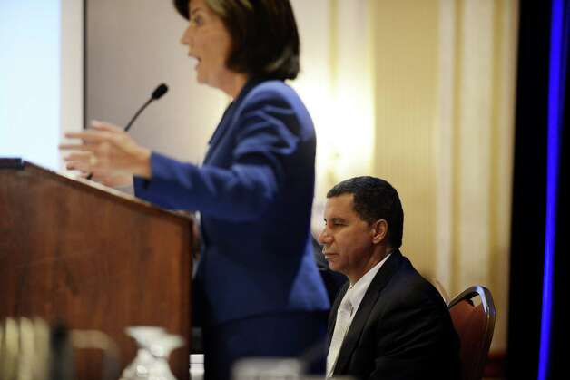 Former governor David Paterson, right, listens to Kathy Hochul, Gov. Andrew Cuomo's running mate, as she addresses the state Democratic Committee fall meeting where Paterson was named chairman of the New York Democratic Party Monday, Sept. 22, 2014, at the Desmond Hotel in Colonie, N.Y. (Will Waldron/Times Union) Photo: WW / 00028714A