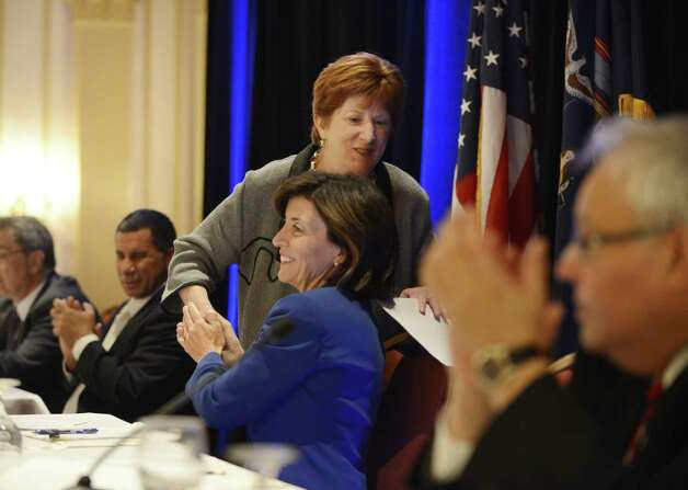 Albany Mayor Kathy Sheehan is congratulated by Kathy Hochul, Gov. Andrew Cuomo's running mate, following Mayor Sheehan's speech to the state Democratic Committee Monday, Sept. 22, 2014, during the parties fall meeting at the Desmond Hotel in Colonie, N.Y. (Will Waldron/Times Union) Photo: WW / 00028714A