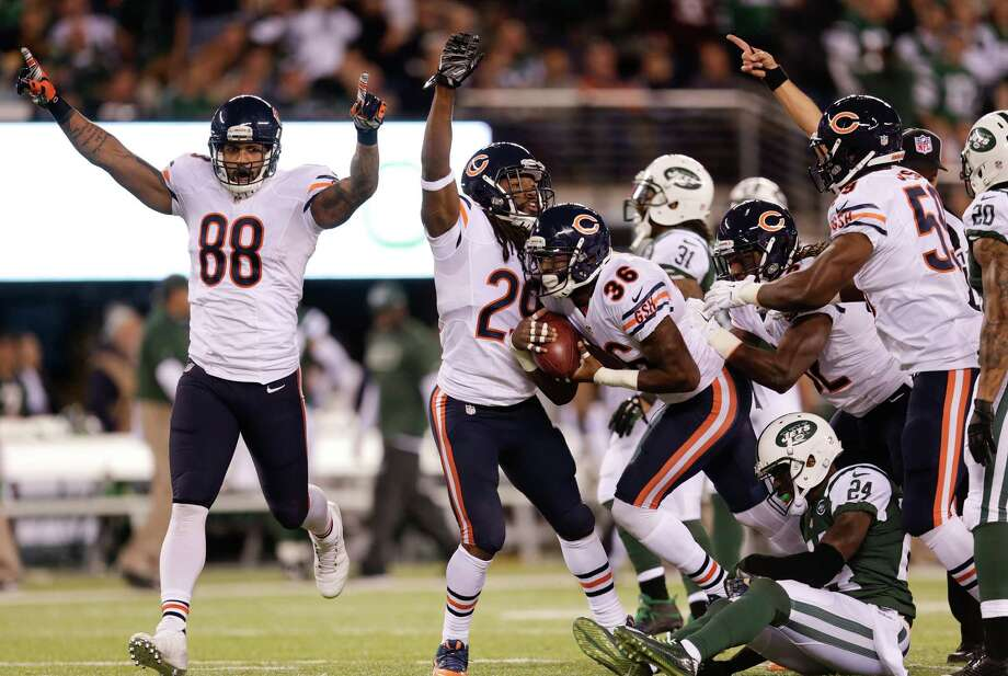 The Chicago Bears celebrate a fumble recovery by defensive back Ahmad Dixon (36) against the New York Jets in the first quarter of an NFL football game, Monday, Sept. 22, 2014, in East Rutherford, N.J. (AP Photo/Julio Cortez)  ORG XMIT: ERU106 Photo: Julio Cortez / AP