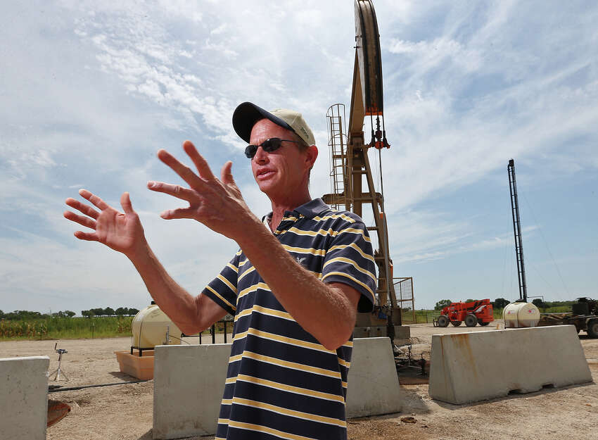 Mark Mutz stands by pump jacks on family land in Kosciusko, Texas, Tuesday, July 15, 2014. The property sits on the edge of the Eagle Ford Shale play in Wilson County. Although the family is seeing money from wells on their property, production is low in the area for companies to build a gas pipeline. Instead the natural gases are burned off through flaring.