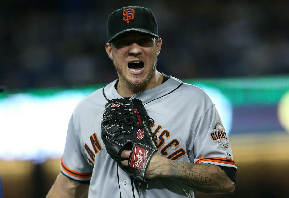 Starting pitcher Jake Peavy of the San Francisco Giants shouts as he comes off the field after finishing a scoreless seventh inning against the Los Angeles Dodgers at Dodger Stadium. Photo: Stephen Dunn, Getty Images
