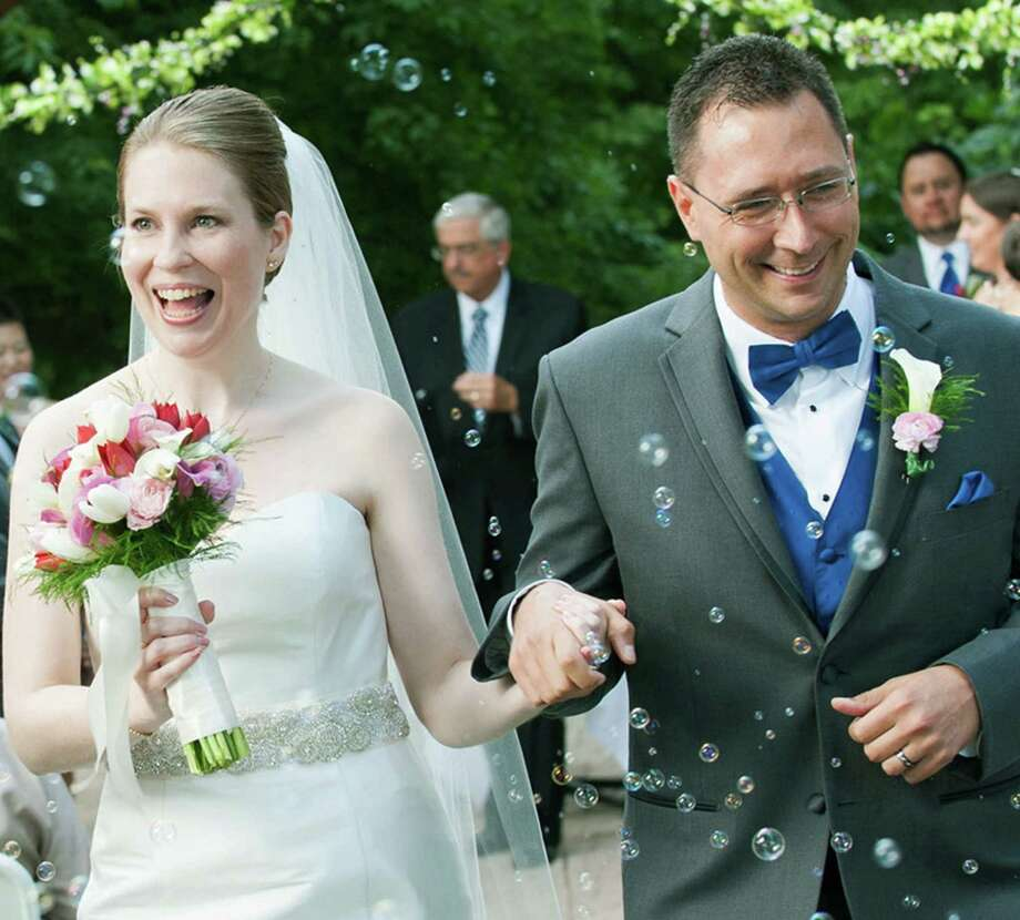 Vanessa Nichole Simpson and Michael Allen Kraeuter of Reston, Va., were married Aug. 17, 2013, at The Woodlands in Sterling, Va.The bride was given in marriage by her parents, Lauren Simpson of New Milford, and Steven Simpson of Newburgh, Ind. The groom is the son of Lewis and Dolores Kraeuter of Lehighton, Pa.  Courtesy of the Simpson family Photo: Contributed Photo / The News-Times Contributed