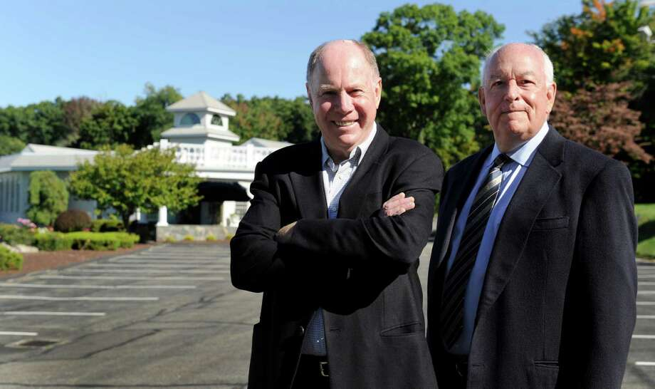 John Royce, left, and Tom Montague, both of Brookfield, Conn.,  are founders and operators of the catering business that provides wedding venues at The Fox Hill Inn and The Candlewood Inn. They are photographed at The Candlewood Inn Tuesday, Sept. 24, 2014. They are the wiinners of this year's WCSU Entrepreneur of the Year award. Photo: Carol Kaliff / The News-Times