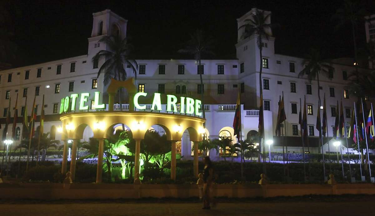 In this April 19, 2012, file photo, people walk past Hotel El Caribe in Cartagena, Colombia. Seven Army soldiers and two Marines have received administrative punishments, but are not facing criminal charges, for their part in the Secret Service prostitution scandal in Colombia. U.S. officials said that one Air Force member has been reprimanded but cleared of any violations of the Military Code of Justice. And final decisions are pending on two Navy sailors, whose cases remain under legal review. (AP Photo/Pedro Mendoza, File)