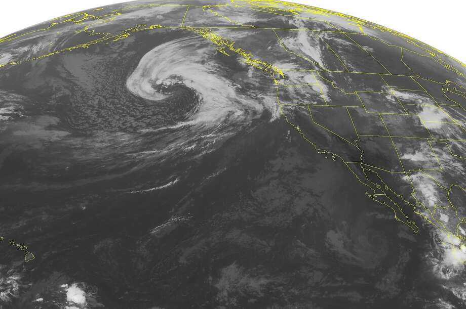 This NOAA satellite image taken Tuesday, Sept. 23, 2014 shows a large ocean storm over the Pacific. That is moving some showers into the Pacific Northwest and the Bay Area by Wednesday night. Photo: Noaa, Associated Press