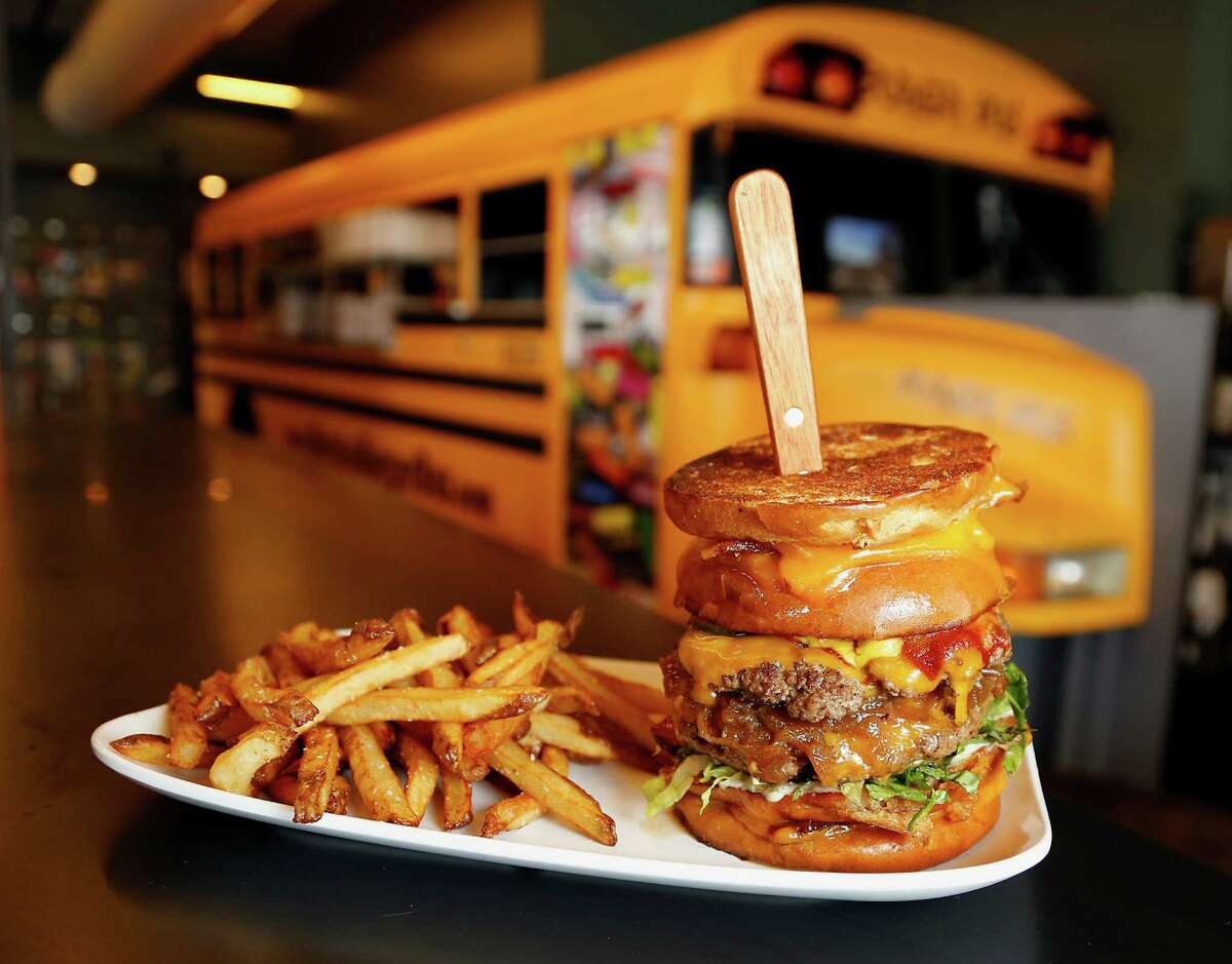 Bernie's Burger Bus' Detention features applewood-smoked bacon and grilled cheeses used as a bun for two patties, each topped with cheddar and onions.