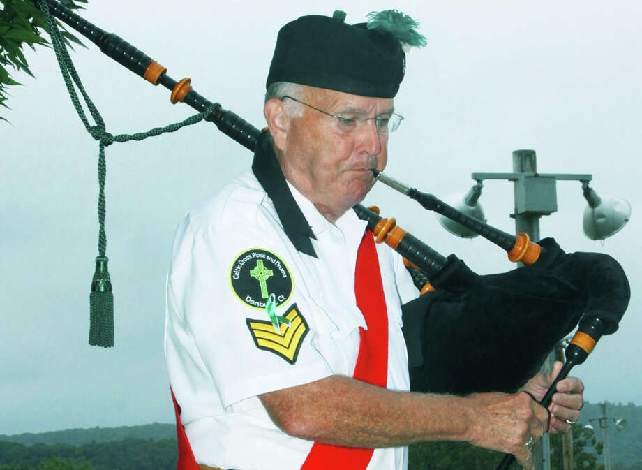 Pat Maguire graces New Milford's annual 9/11 memorial ceremony at Patriot's Way with bagpipe skills, Sept. 11, 2014 Photo: Walter Kidd / The News-Times Freelance